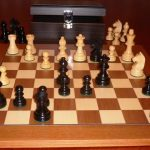 Black Boxwood Chess Set with Teak Board and Chest. 76mm King